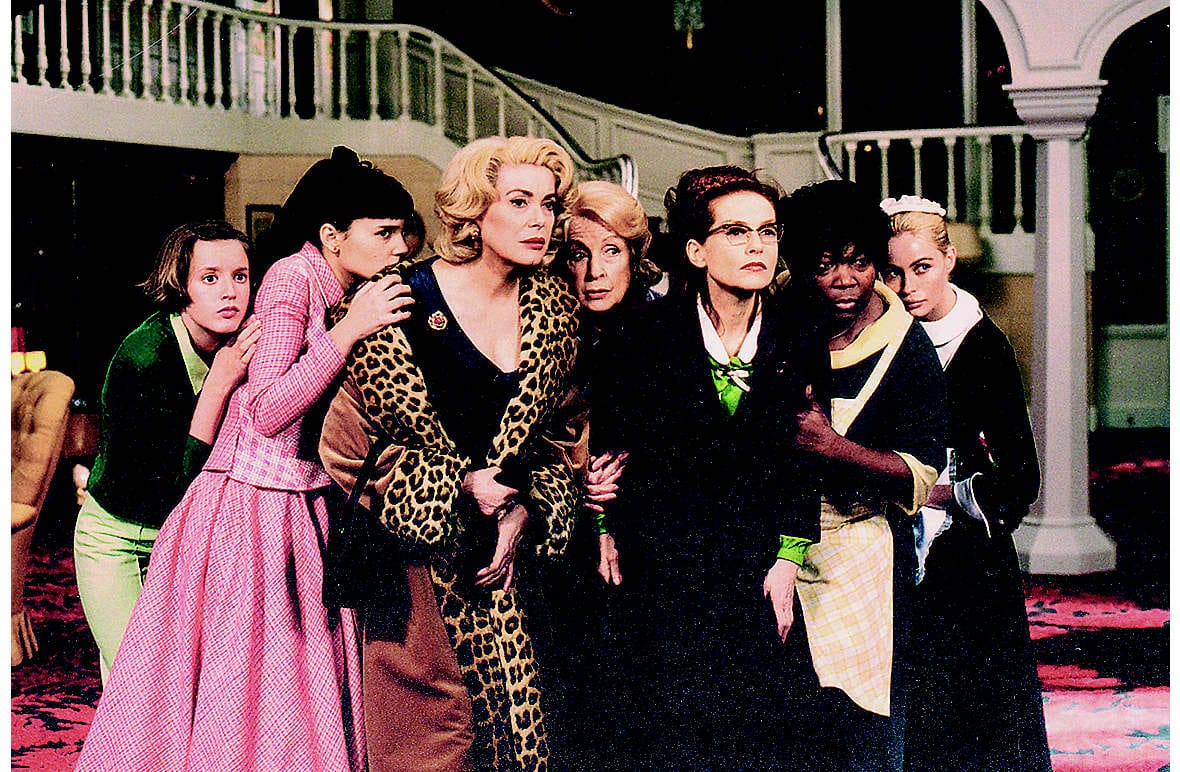 An all-star French cast in the dark comedy film 8 Women (2002), with Isabelle Huppert (third from right), directed by François Ozon