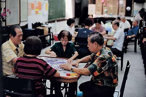 The clack of mahjong tiles is a common sound in the backstreets and social clubs in Chinatown