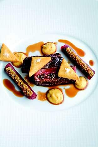 Lightly smoked fillet of beef with red wine, scented beetroot cannelloni and chickpea tart