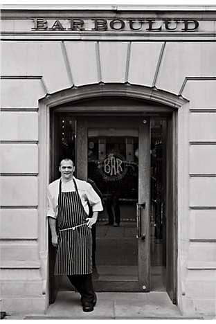 Executive Chef Dean Yasharian outside Bar Boulud's entrance