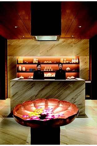 The sleek spa reception on the 37th floor