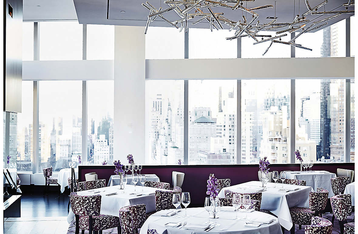 The central dining space, with its decoration inspired by exotic oriental orchids and its 'tree-branch' chandelier