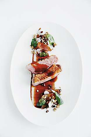 Long Island duck with pomegranate, savoury granola and cardamom jus