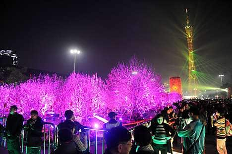 A light show in Huacheng Square for the opening of the Spring Festival Flower Fair