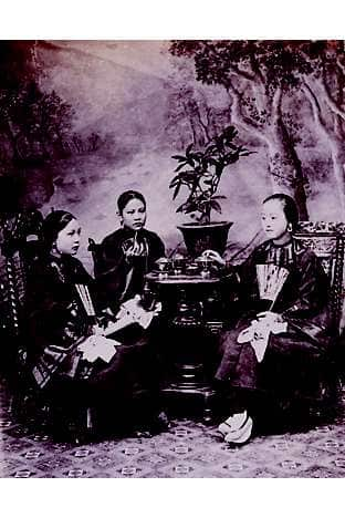 Young Hong Kong women drinking tea together in the late 19th century