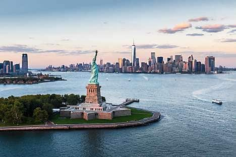 An aerial view of the Statue of Liberty and Manhattan