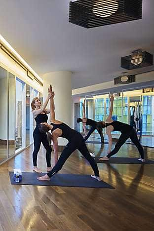 Taking a class at the Mandarin Oriental yoga studio