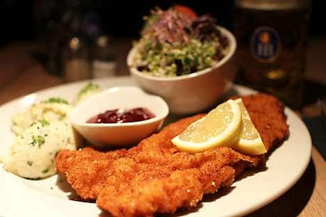 Schnitzel with lingonberries and sprout salad at Spezlwirtschaft