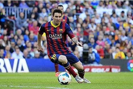 Leo Messi playing for FC Barcelona