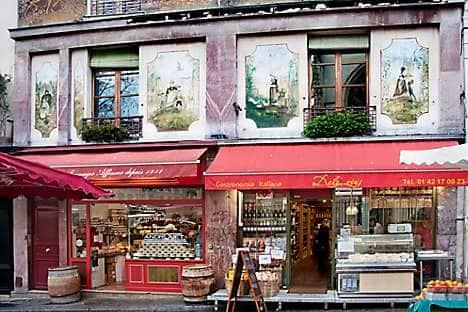 Cheese shops in market street Marché Mouffetard