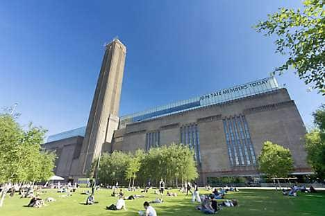 View modern art at Tate Modern in a building overlooking the Thames