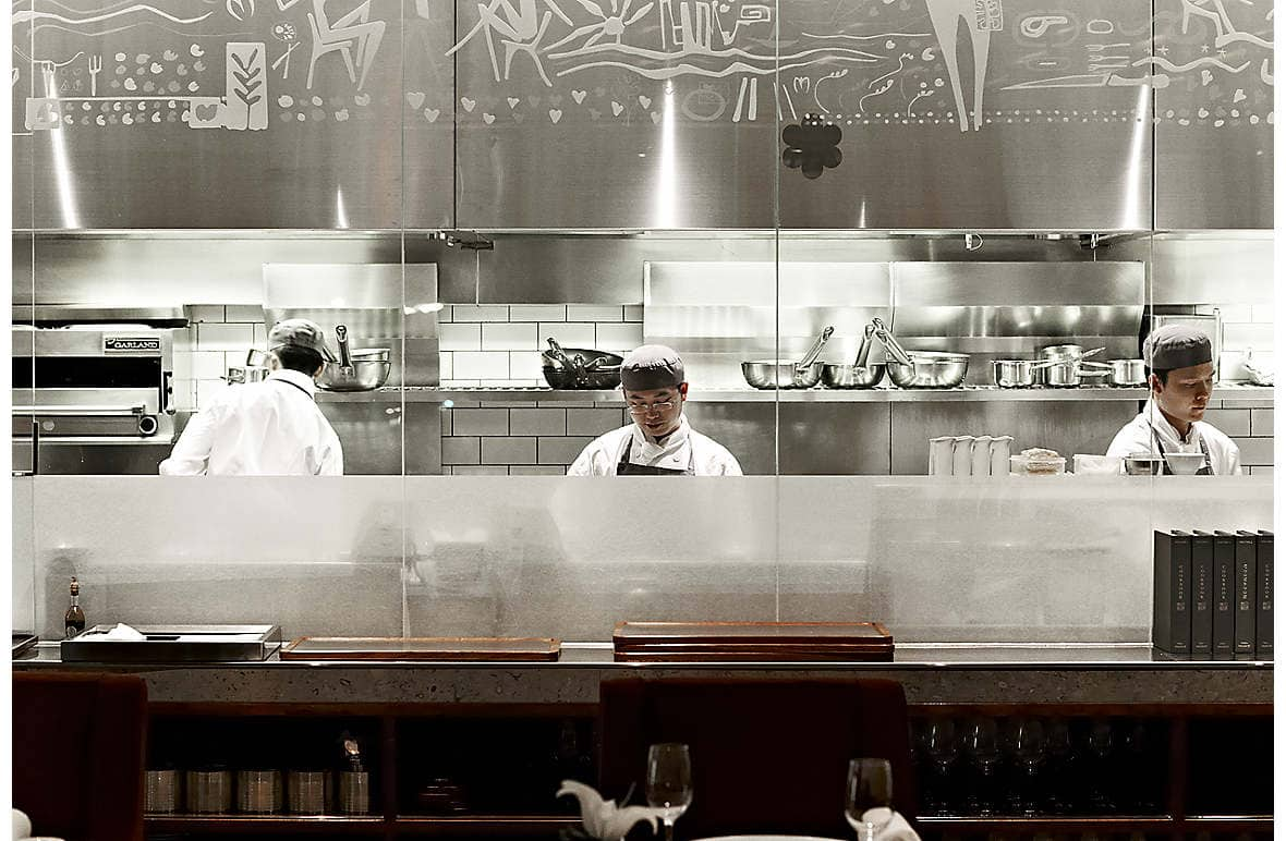 The Mandarin Grill + Bar's open kitchen allows guests to view the chefs at work