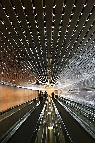 the Multiverse light sculpture by American artist Leo Villareal incorporates a moving walkway that connects the East and West Buildings of the National Gallery of Art