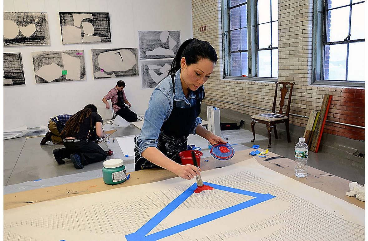 Lucy Liu painting in her New York studio