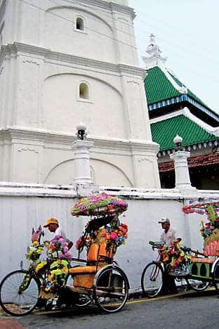 Trishaws embellished with fake flowers in Malacca