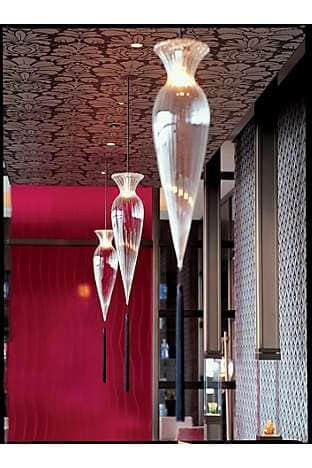 Murano glass lampshades, like upturned candle holders, illuminate the beautiful Sense restaurant