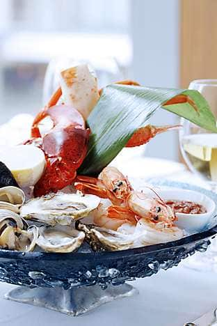 Fruits de la mer with snow crab, prawns, oysters, mussels, clams and marine lobster