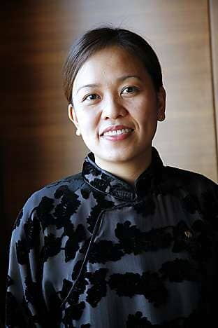 A Spa receptionist wears a Vivienne Tam uniform