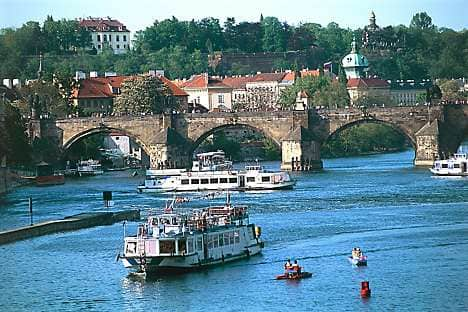 Boats on the Vltava river, upstream from the embankment known as Náplavka