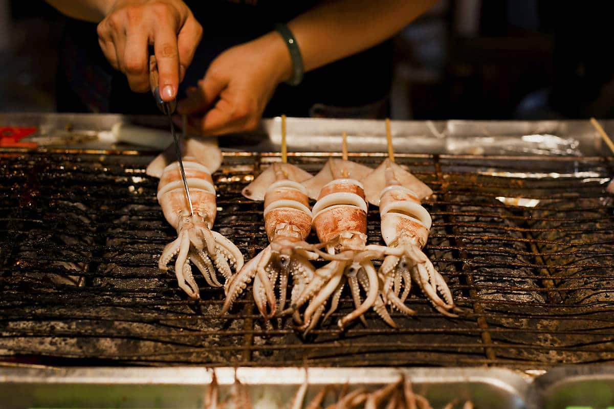 Grilled squid on a stick at Ningxia Night Market