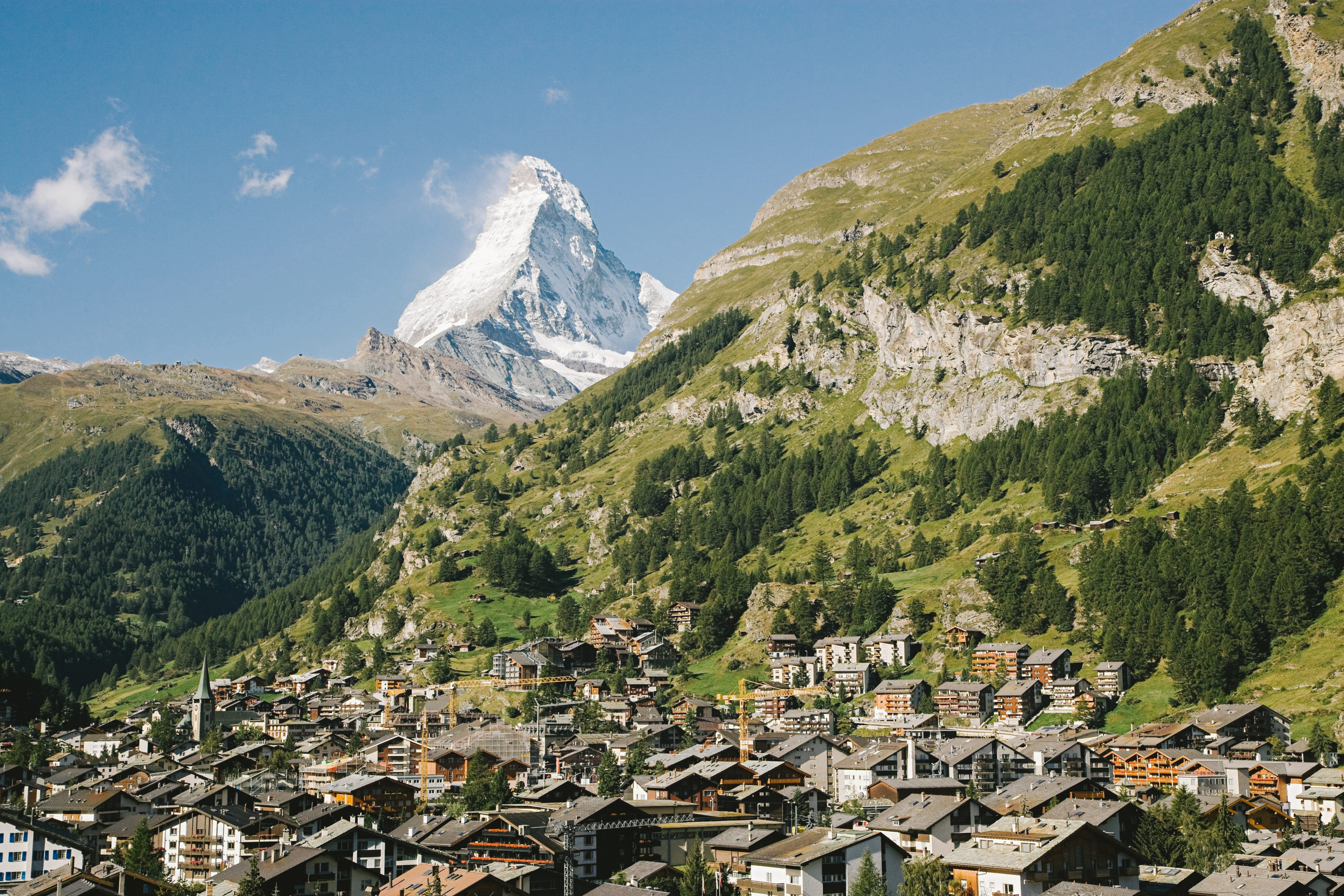 View of the town of Zermatt with the imposing mountains behind