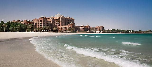 View of Emirates Palace from the beach daytime