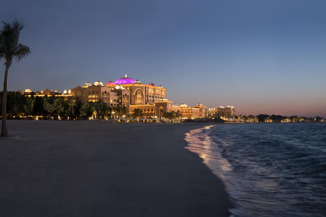 View of the hotel from the beach in the evening