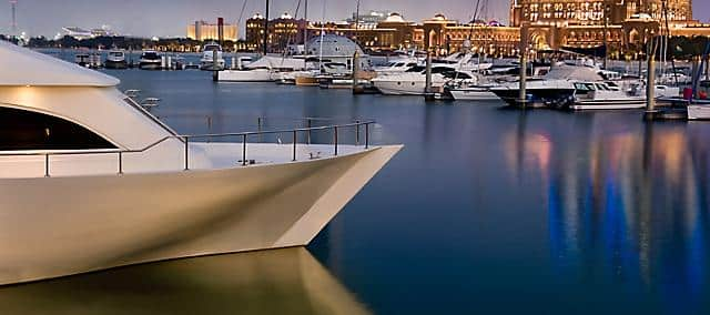 view of marina with yatch in evening