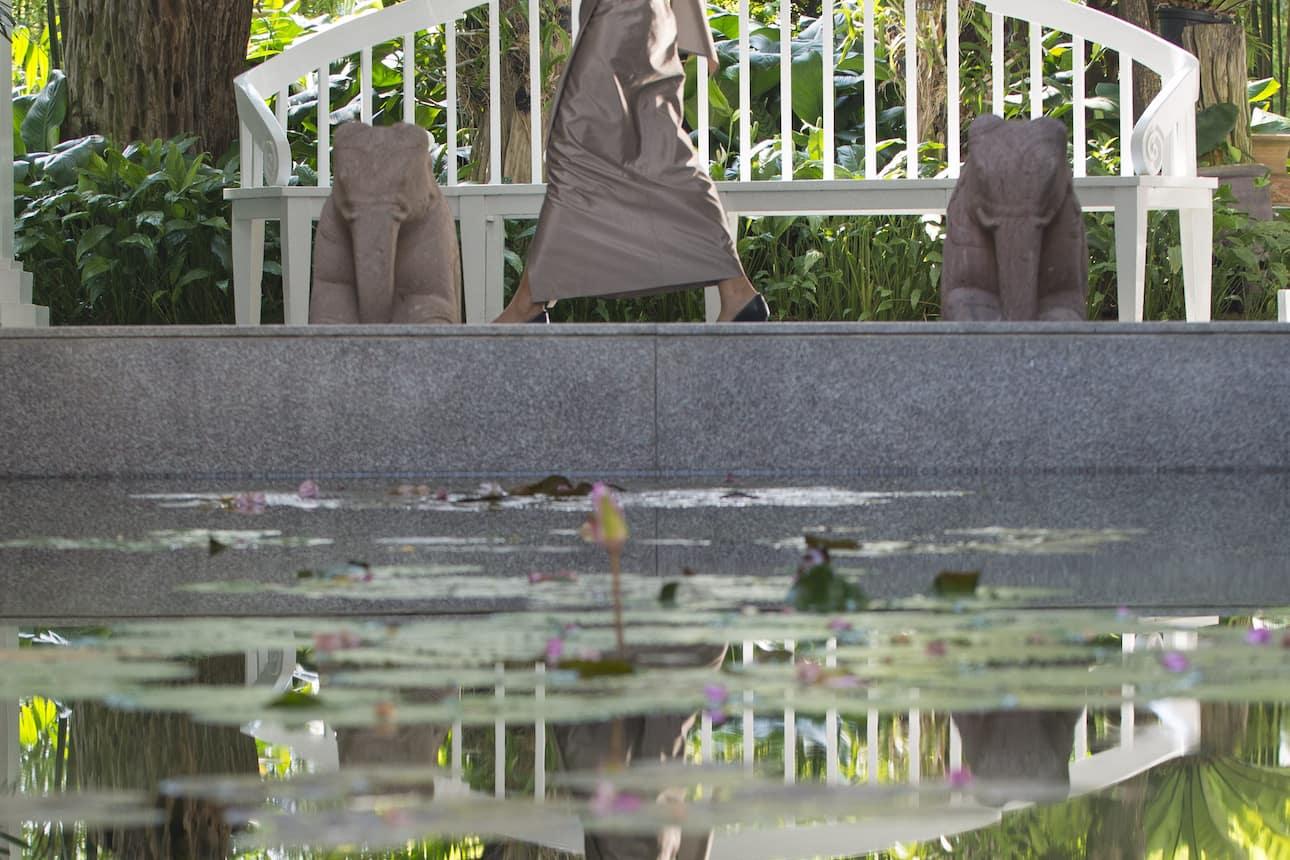Woman walk past pool