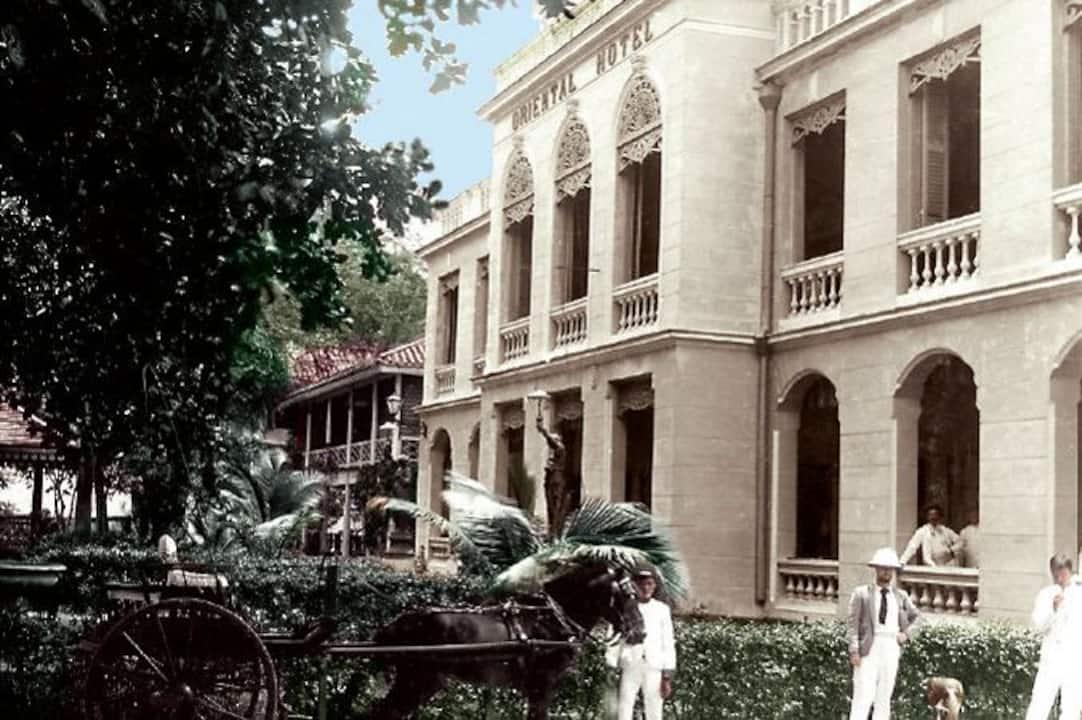 historical photo of hotel exterior in color at mandarin oriental, bangkok