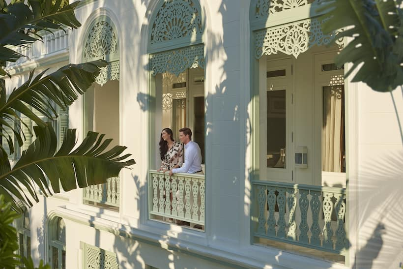 a couple standing at balcony