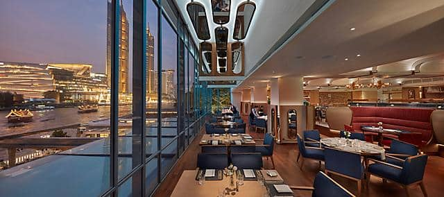 lord jim restaurant with river view in evening at mandarin oriental, bangkok
