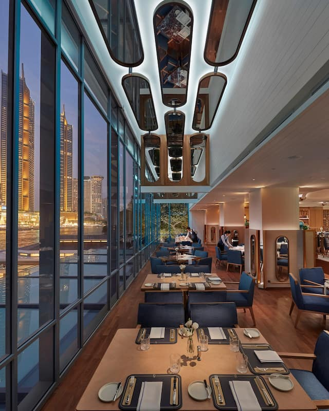 lord jim interior with river view at mandarin oriental, bangkok