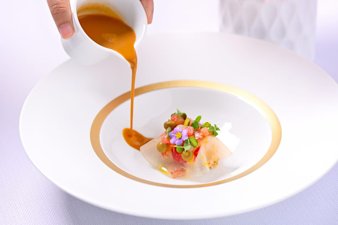 saurce pouring into a dish