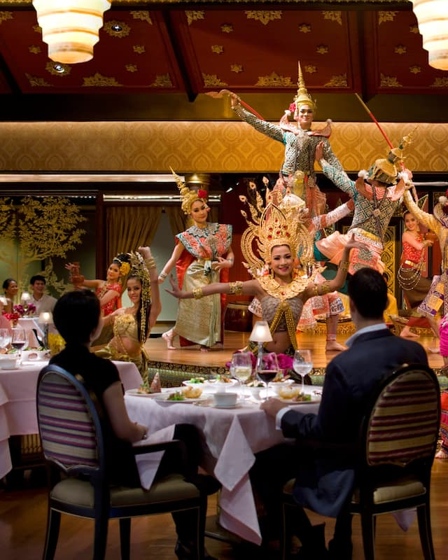 performing traditioanl thai dance in sala rim naam at mandarin oriental, bangkok