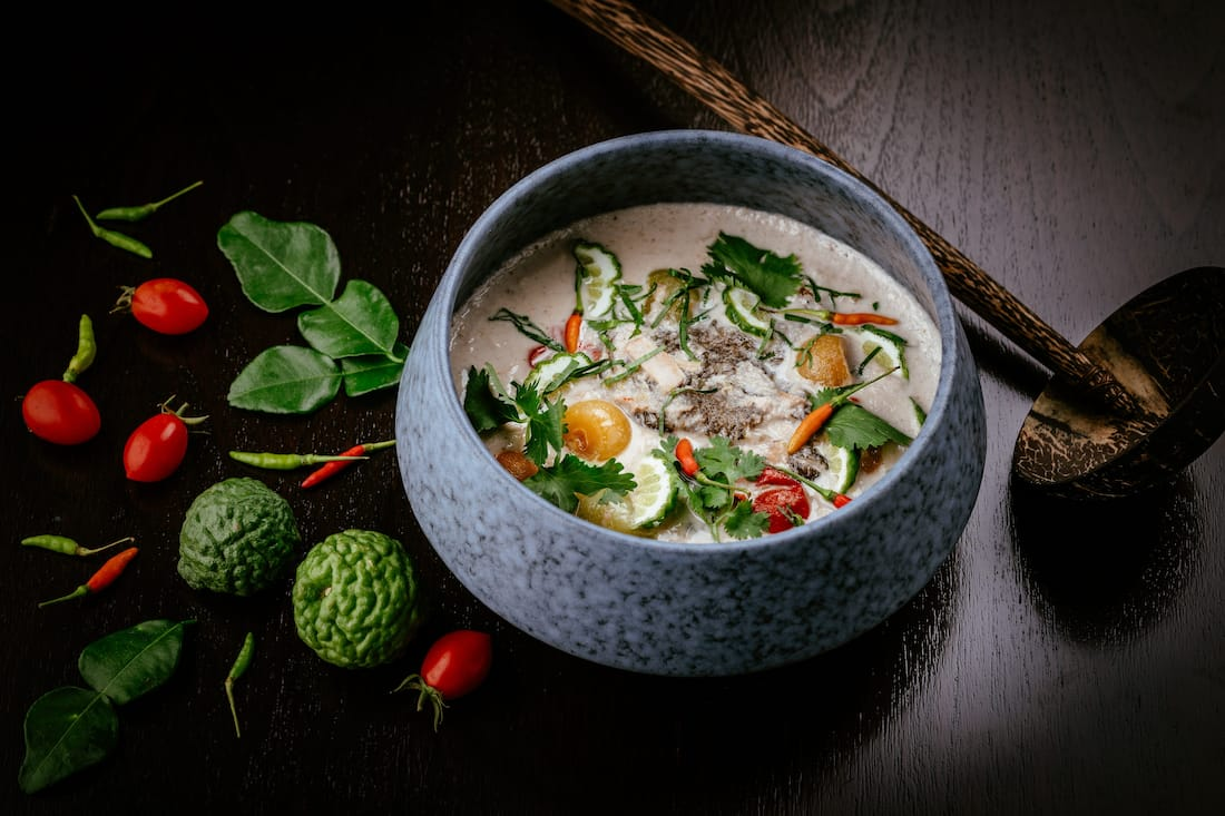 Traditional coconut soup with gourami fish