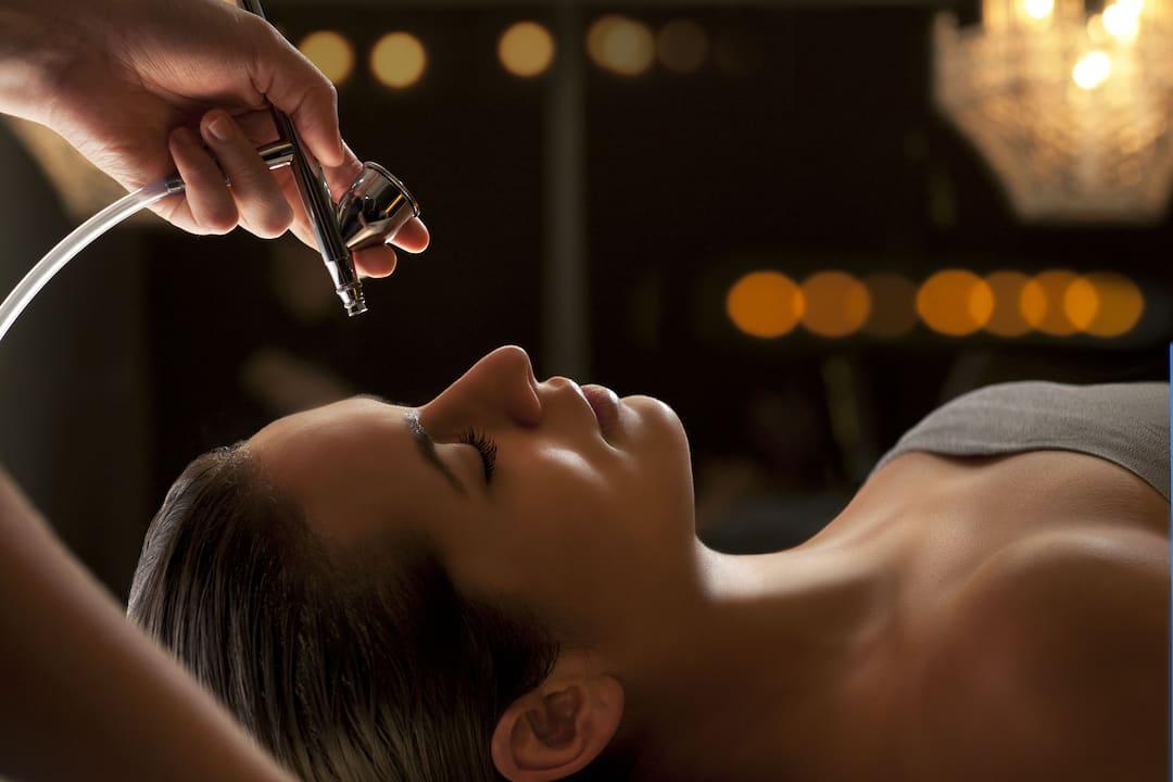 a woman having facial