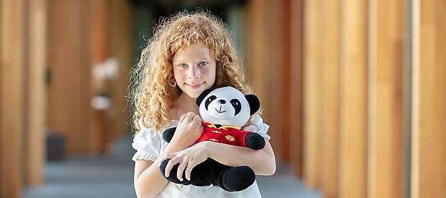 kids with panda doll