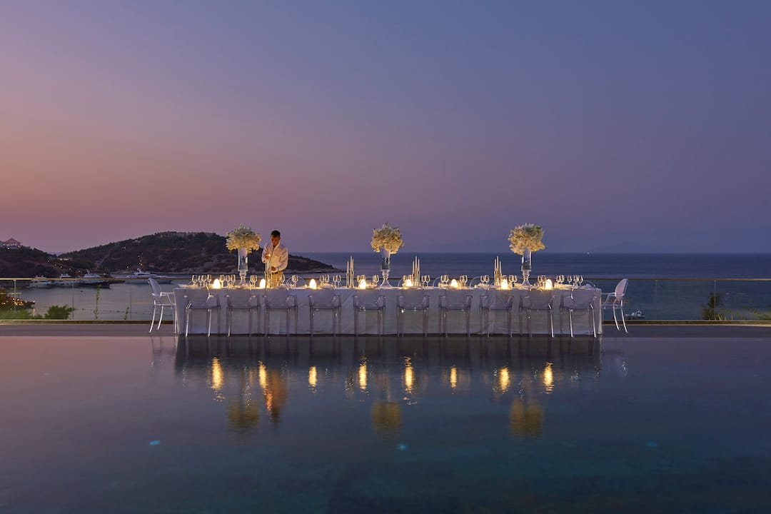 outdoor banquet setting beside the pool