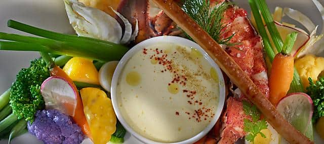 salad with creamy sauce, lobster and assorted vegetable like carrot celery and beet