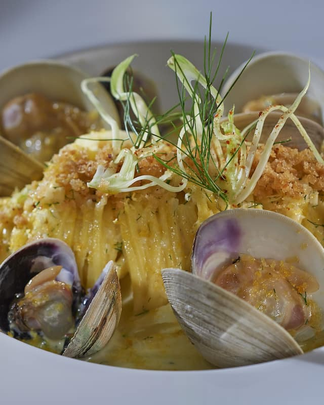 linguine with clams in a white plate