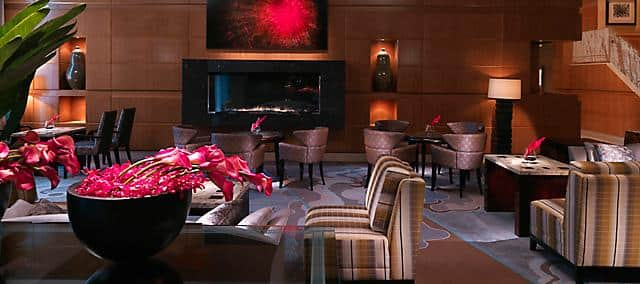 lobby with lounge seating and black fireplace