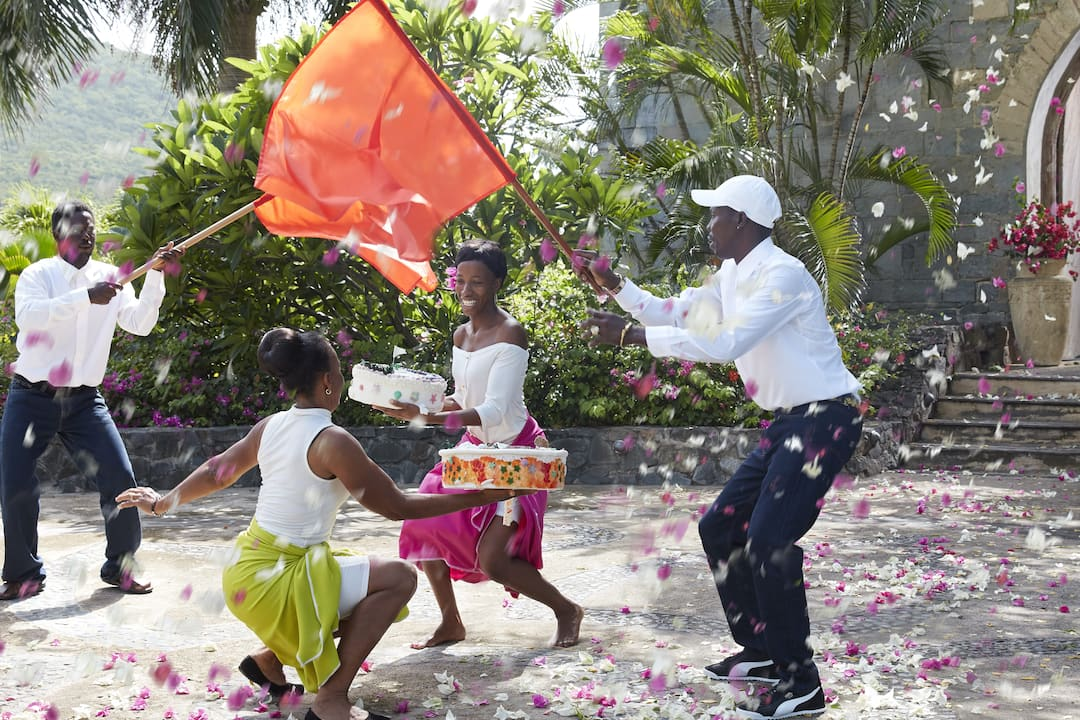 Canouan hotel staffs dancing with cakes