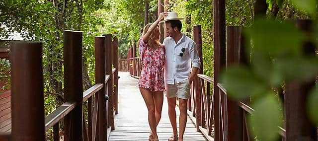 couple walking to spa