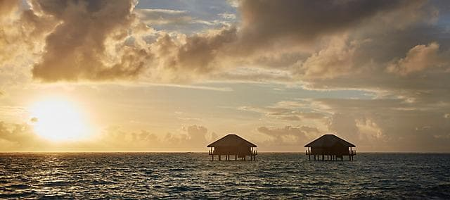 two huts above the ocean