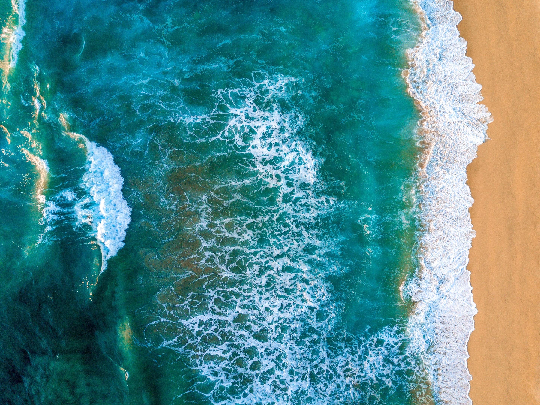 Ocean waves lapping the beach at a Mandarin Oriental hotel