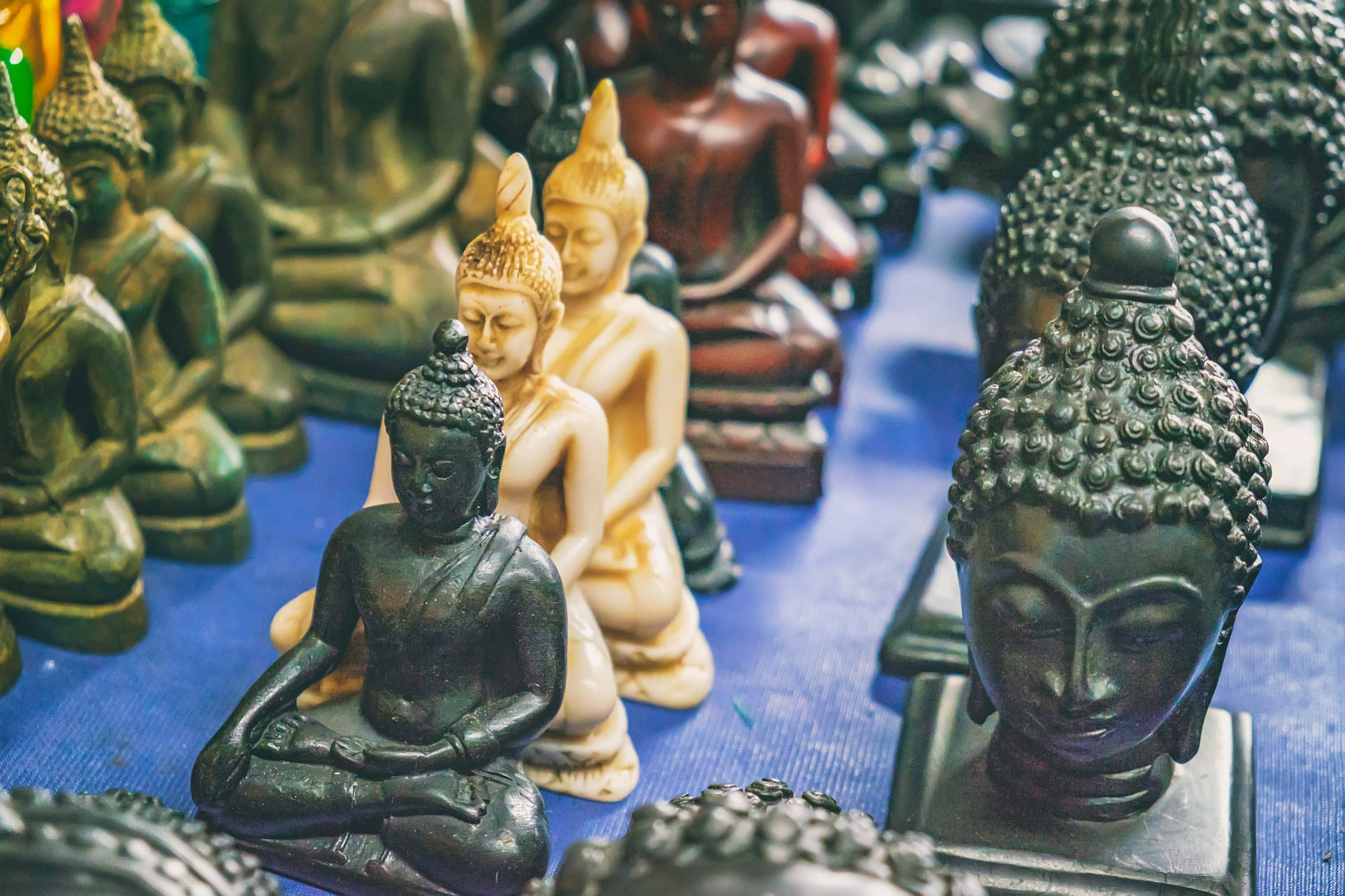 Rows of Buddha statues for sale on a market stall
