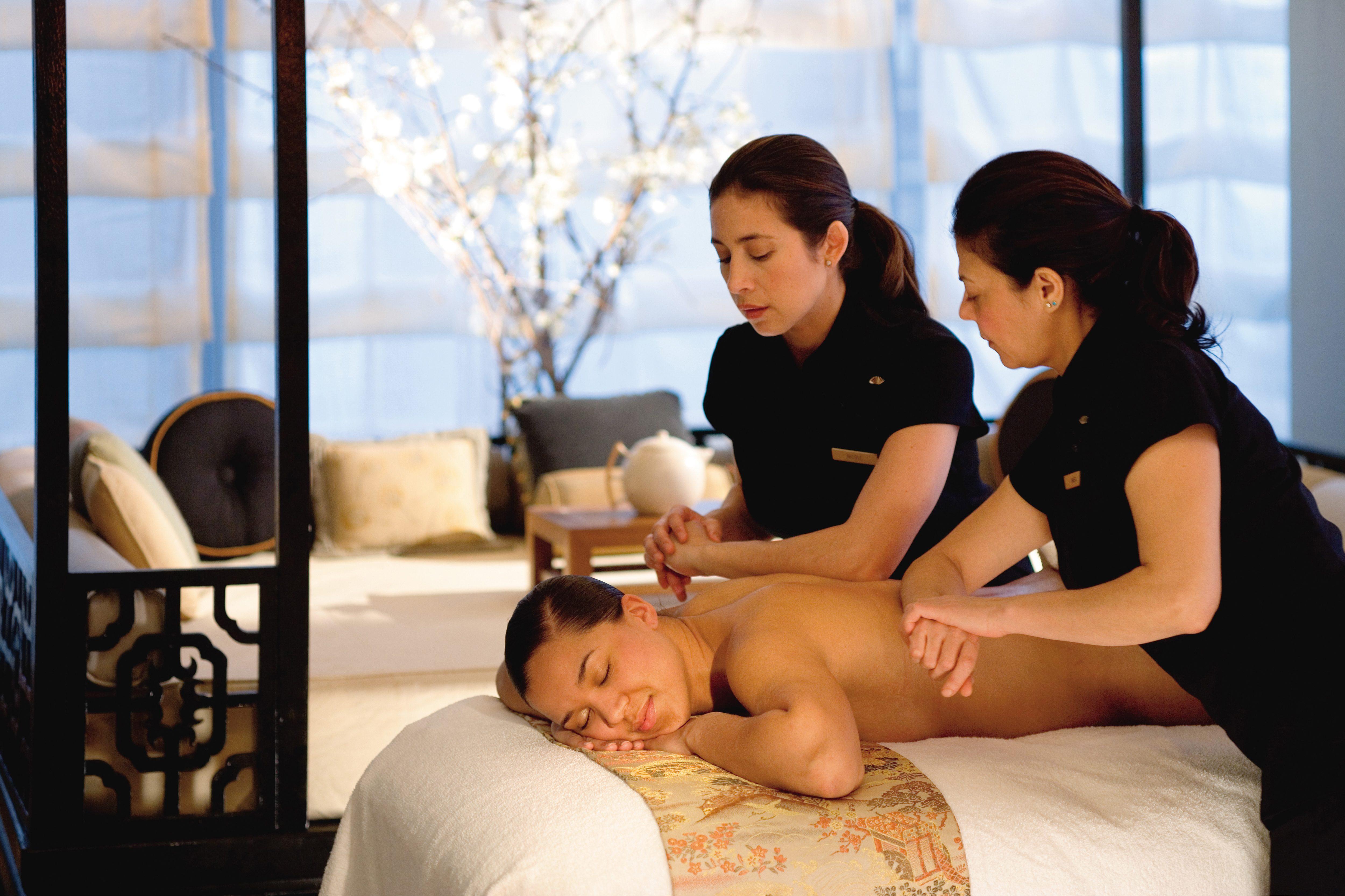 Therapists at Mandarin Oriental performing a massage treatment