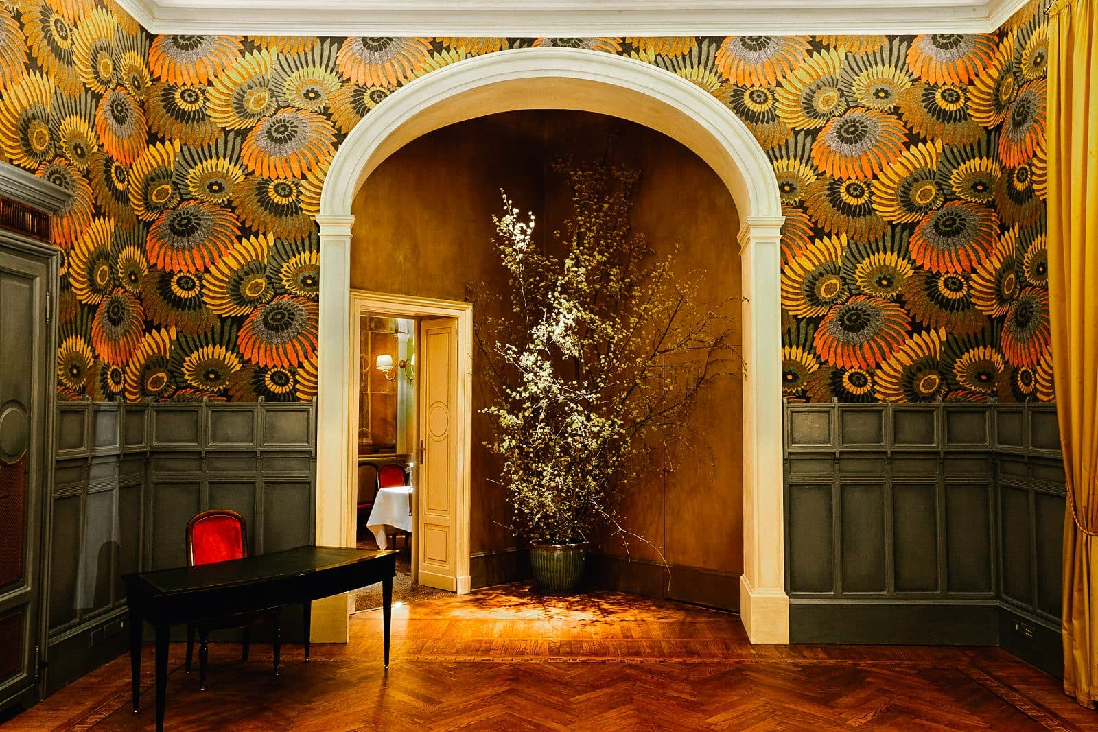 The green and orange patterned wallpaper and wood panelling inside Cracco