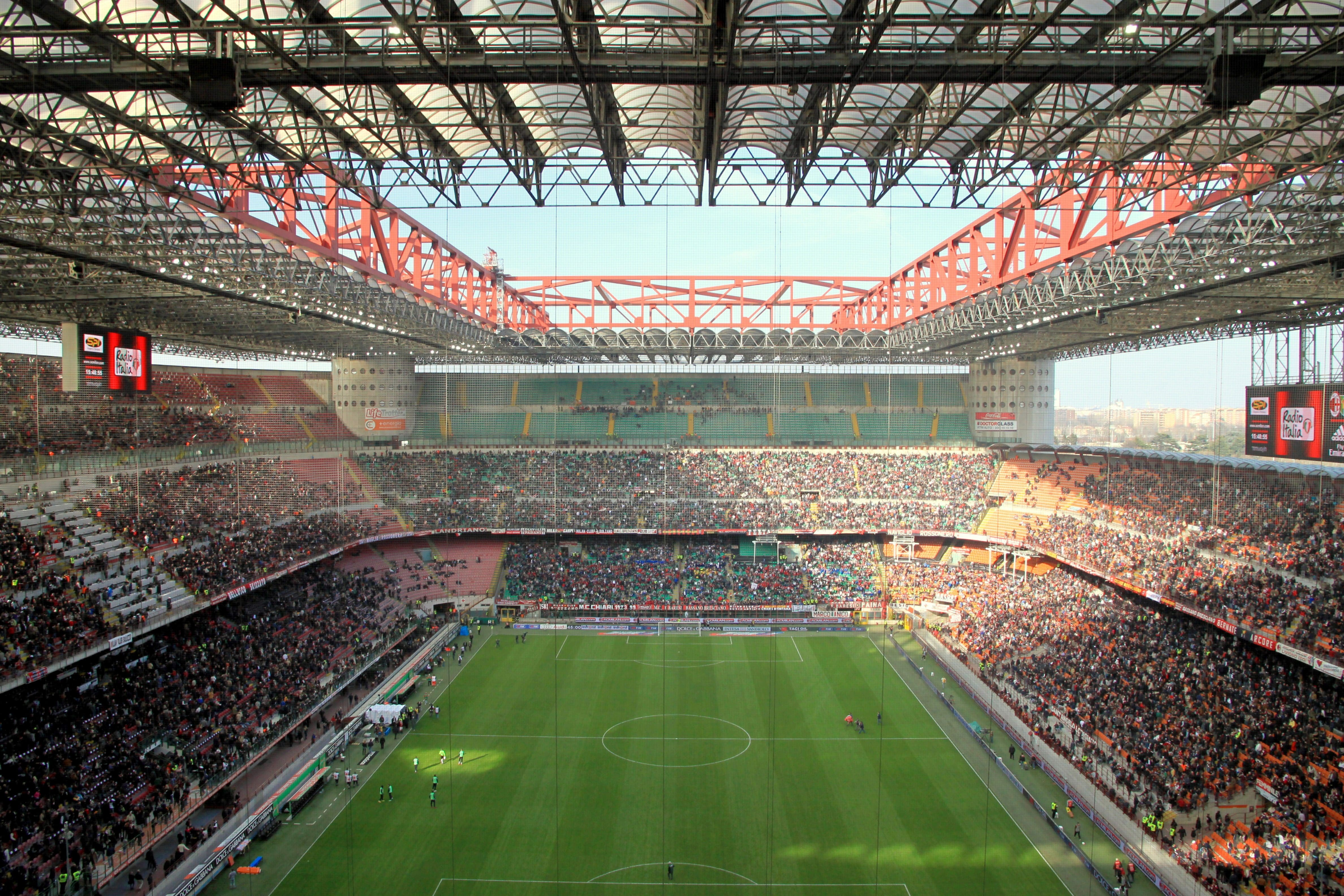 The open-roofed San Siro stadium full of spectators ready for the start of a football match